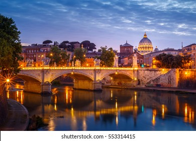 Sunset view of St. Peter's Basilica in the Vatican and the Ponte Sant'Angelo, at St Angel bridge,the Castel Sant'Angelo and river Tiber in Rome, Italy