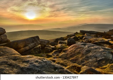 sunset view at Stanage Edge in Peak District National Park Derbyshire England