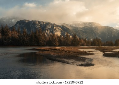 Sunset view of the Stawamus Chief, a  massive cliff face that  is one of North America's largest granite monoliths. Picture taken from the Estuary in Squamish BC