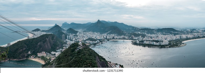 sunset view from sugarloaf to rio de janeiro cityscape and ocean in panorama