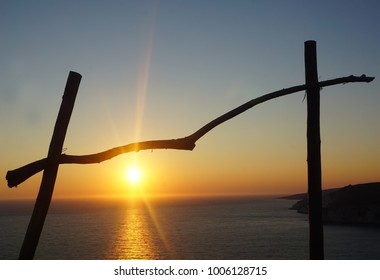 Sunset view through wooden frame at Zakynthos island in Greece