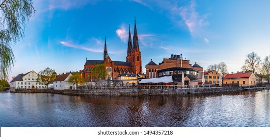 Sunset view of Uppsala cathedral reflecting on river Fyris in Sweden