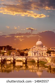 Sunset view of the Vatican with Saint Peter's Basilica and Sant'Angelo's Bridge (Rome, Italy)