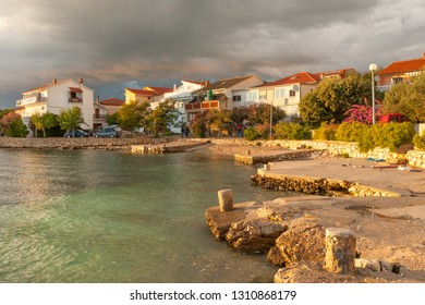 Sunset view of waterfront of quiet Mandre village on Pag island, Croatia