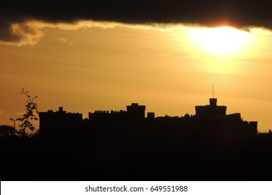 A sunset view of Windsor castle, looking south from Slough in Berkshire