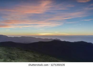 Sunset views of Sweeney Ridge top and the Pacific Ocean. Sweeney Ridge, Pacifica and San Bruno, San Mateo County, California, USA.