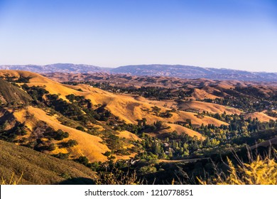 Sunset views towards Danville and the hills surrounding Mt Diablo State Park on a sunny day; San Francisco bay area, Contra Costa county, California