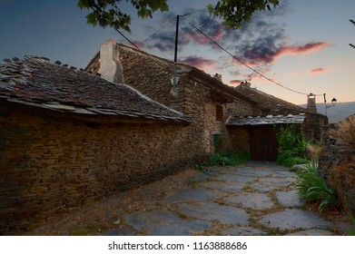 Sunset in the village with of house with stone wall
