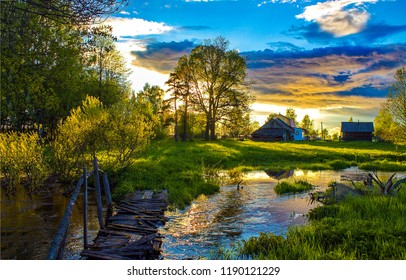 Sunset village river landscape. Russian village sunset view. Sunset russian village river panorama. Sunset village river in Russia
