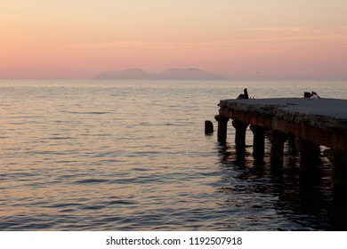 Sunset from Vlora marina over the Llogara National Park. Albania