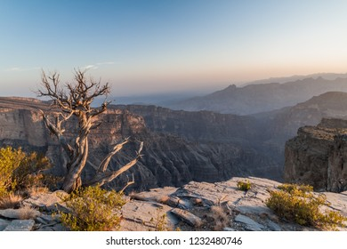 Sunset at Wadi Ghul canyon in Hajar Mountains, Oman