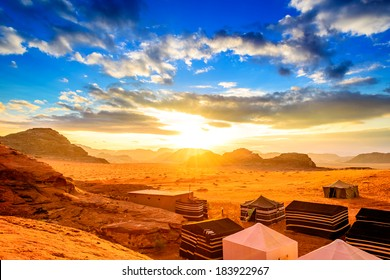 Sunset in Wadi Rum, Jordan. Wadi Rum is known as The Valley of the Moon and has led to its designation as a UNESCO World Heritage Site.