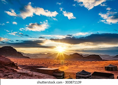 Sunset in Wadi Rum, Jordan. Wadi Rum is located about 60 km to the east of Aqaba. It has led to its designation as a UNESCO World Heritage Site and is known as The Valley of the Moon.