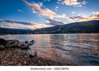 Sunset at Wanaka lake front from Eely Point Recreation Reserve. Wanaka is a popular ski and summer resort town in the Otago region of the Southern Island of New Zealand.