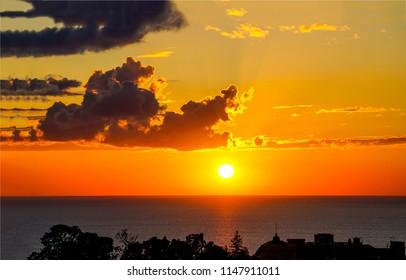 Sunset water horizon sky clouds panorama. Sunset sea horizon landscape. Sunset ocean horizon view
