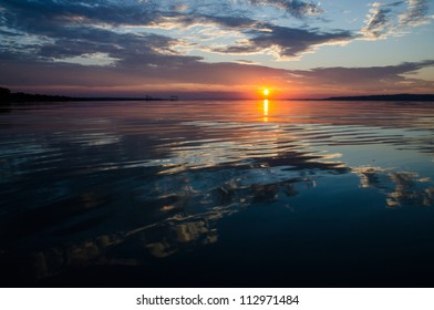 Sunset with water and mountains