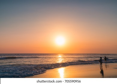 Sunset Waves and Amazing Landscape Ocean. Orange Ocean Beach. Sun rays in a Colorful Sunset Background. Beautiful Sky, Water Sunset Background. Clear Tropical Island View and Sunset Beach Background.
