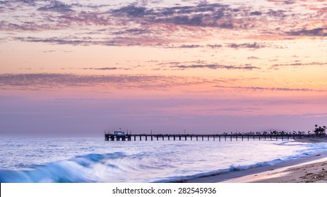 Sunset and waves at Balboa Pier, Newport Beach, California