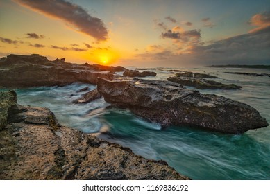 Sunset an the waves at Mengening Beach, Bali, Indonesia