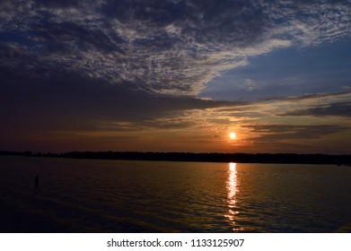 Sunset where Lake Michigan and the Macatawa River meet.