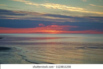 Sunset White Sea, Russia .Sandy shore of the south coast