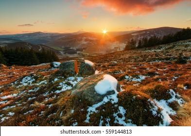 Sunset in Wicklow Mountains/ Last beam / Sunset at Wicklow Mountains, Ireland in winter.