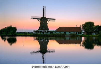 Sunset windmill farm river reflection. Windmill sunset river. Sunset windmill river