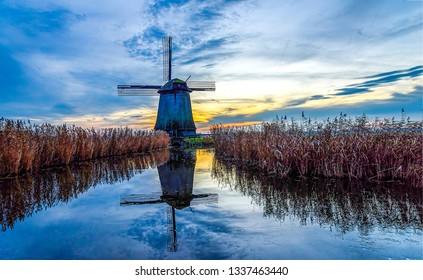 Sunset windmill river reflection landscape. Windmill farm sunset river. Sunset windmill river reflection. Windmill farm sunset water