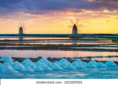 Sunset at Windmills in the salt evoporation pond in Marsala, Sicily island, Italy