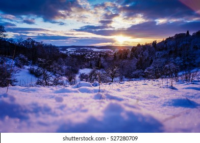 A sunset in the winter with a castle and snow in Coburg