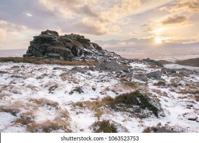Sunset in winter on Higher Tor Dartmoor Devon Uk