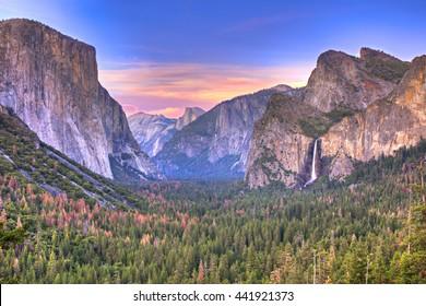 Sunset at Yosemite National Park, with Bridalveil Fall, El Capitan and Half Dome.