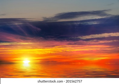Sunset-fire against the sea. Flame-haired beauty