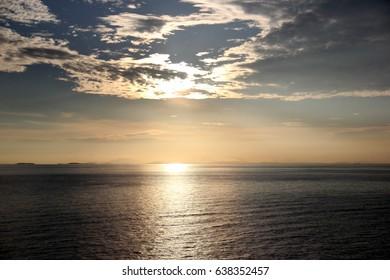 Sunsets. Sunset at sea.