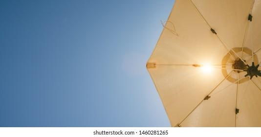 sunshade against blue sky on a warm sunny summer day