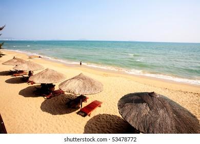 Sunshade and chairs on beach, Sanya, China