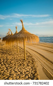 Sunshades waiting for beachgoers in Santa Pola, Costa Blanca, Spain