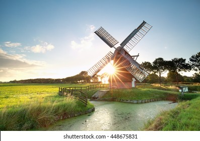 sunshine behind Dutch windmill, Groningen, Netherlands