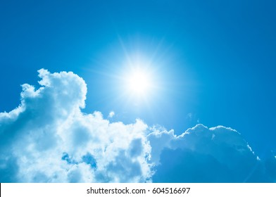 Sunshine and clouds with a blue, blue sky.