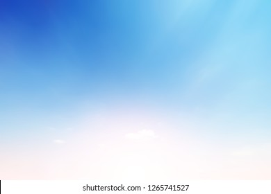 Sunshine clouds sky during morning background. Blue,white pastel heaven,soft focus lens flare sunlight. Abstract blurred cyan gradient of peaceful nature. Open view out windows beautiful summer spring