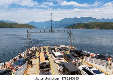 Sunshine Coast, British Columbia, Canada - July 31, 2020: BC Ferries fully loaded with cars and passengers during a sunny summer day.