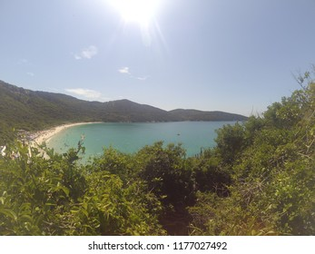 Sunshine and crystal blue water on a Brazillian beach Praia do Forno viewed from a forest montain, Arraial do Cabo, Rio de Janeiro, Brazil.
