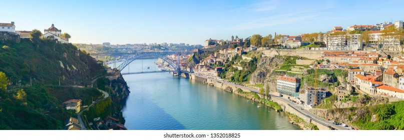 Sunshine panorama of Porto downtown on Douro river banks with famous Dom Luis I Bridge, Portugal