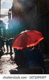 Sunshine in the rain and red umbrella