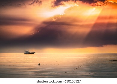 Sunshine ray and with rain on far away background,Traveling long tail boat in summer at Andaman sea,Colorful sky in twilight,Lipe island,Koh Lipe Stul Thailand. - Shutterstock ID 630158327
