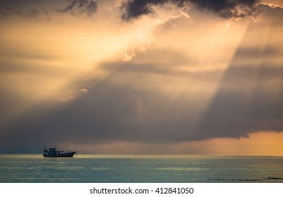 Sunshine ray and the sea with rain on far away background,Emerald sea,God ray from sky,Traveling long boat,scuba boat,summer at Andaman sea,Colorful sky in twilight,Lipe island,Koh Lipe Stul Thailand. - Shutterstock ID 412841050