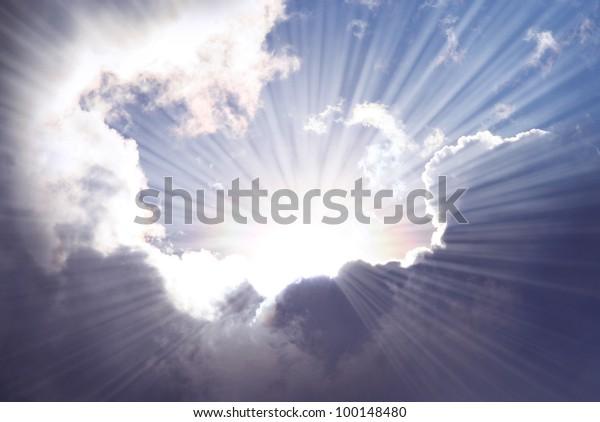 Sunshine rays among dramatic clouds.