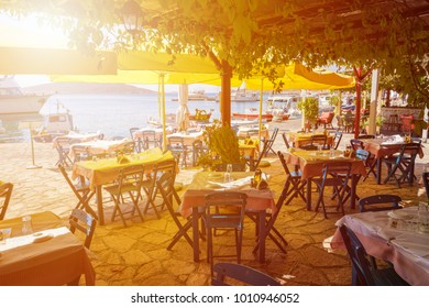 Sunshine in restaurant in harbor of Nimborio on island of Halki (Greece)