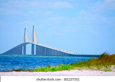 Sunshine Skyway Bridge crossing Tampa Bay in Florida with a beach in the foreground