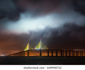 Sunshine Skyway Bridge in Tampa Bay Saint Petersburg Florida at night in a stormy sky